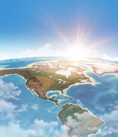 Sun shining through clouds, in blue sky, over a high detailed satellite view of Planet Earth, focused on America. 3D illustration