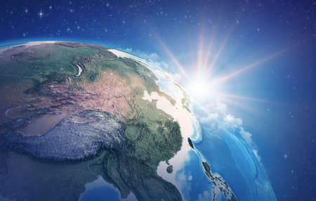 Sunrise through clouds, upon a high detailed satellite view of Planet Earth, focused on China, East Asia. 3D illustration 免版税图像