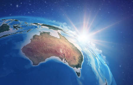 Sunrise through clouds, upon a high detailed satellite view of Planet Earth, focused on Australia. 3D illustration 免版税图像