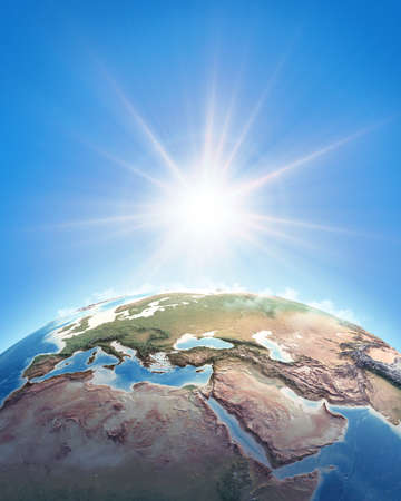 Sun shining over a high detailed view of Planet Earth, focused on Western Europe, North Africa and Middle East. 3D illustration