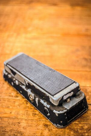 Vintage Wah Pedal on a Dirty Hard Wood Floor.