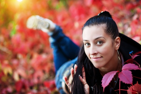 Young pretty woman rest in the autumn park Stock Photo - 12164236