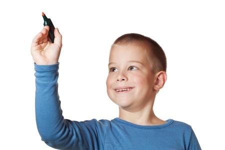 pre schooler: smiling Boy holding a marker