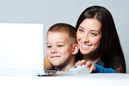 Mother and  son  working using laptop photo