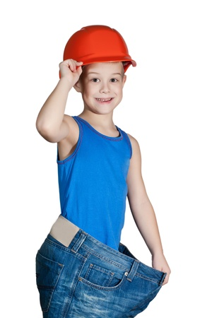 little boy with hard hat and in too big jeans Stock Photo - 12011237