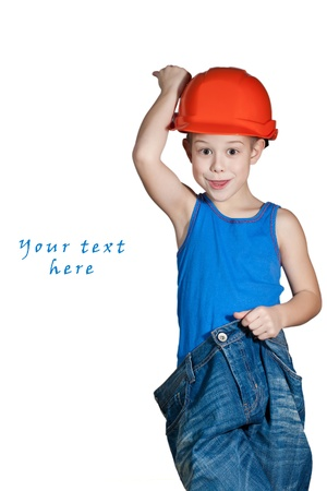 little boy with hard hat and in too big jeans Stock Photo - 12011238