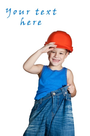 little boy with hard hat and in too big jeans Stock Photo - 12049052