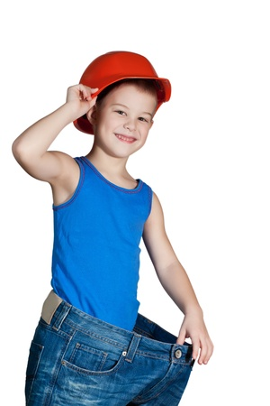 little boy with hard hat and in too big jeans Stock Photo - 12049049