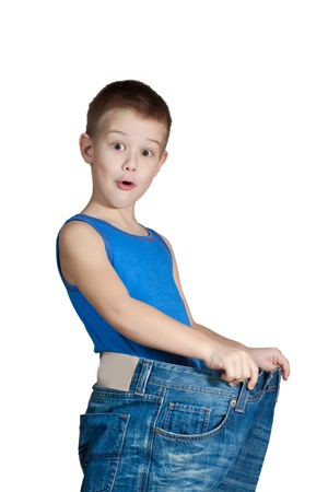 scamp: Kid in too big jeans Stock Photo
