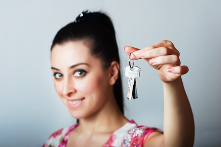 Realtor is giving the keys to an apartment