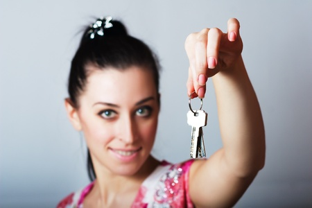 Realtor is giving the keys to an apartment photo