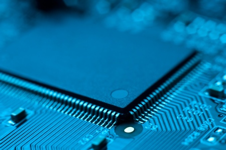 tech background: electronic circuit board with processor Stock Photo