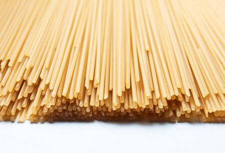 raw pasta on a white background photo