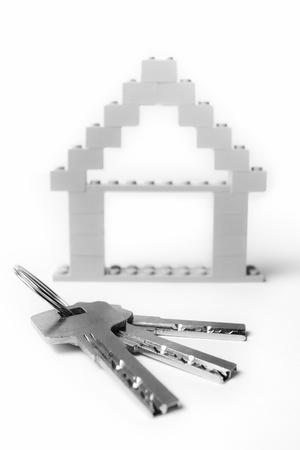 keys with house on background photo