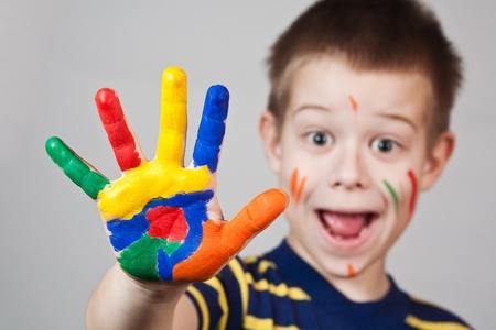 child showing his colored hands Stock Photo