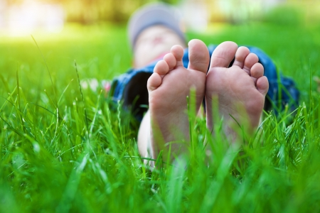 feet on grass  Family picnic in spring park Stock Photo