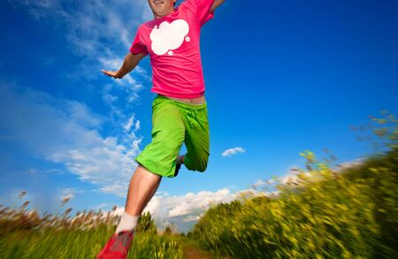 athlete runing against the blue sky background Stock Photo - 14121814