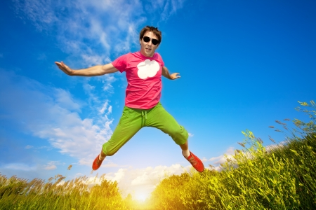 athlete man runing against the blue sky background Stock Photo - 14286854