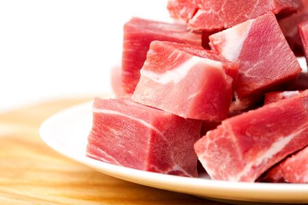 pieces of frozen meat isolated on a white background photo