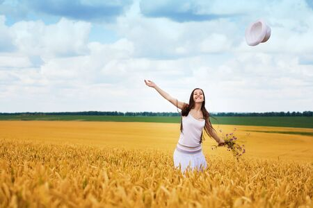 girl with white  hat enjoying the wonderful weather in the field