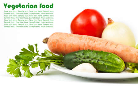 Fresh raw vegetables in plate isolated on white background