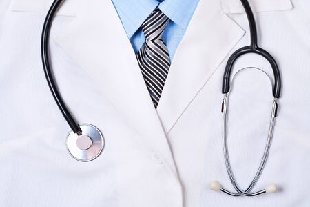 white coat: Close up of a doctors lab white coat with stethoscope