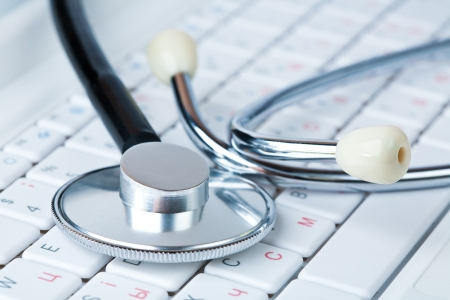 Stethoscope on a modern pc keyboard photo