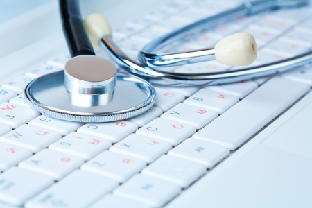Stethoscope on a modern pc keyboard Stock Photo