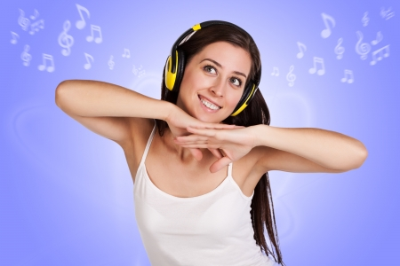 musical notation: attracive girl is listening music with headphones on musical notation background Stock Photo