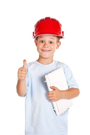 little boy with note and in hard hat  photo