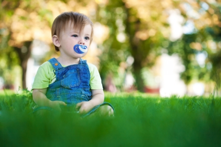 baby in a beautiful summer park photo