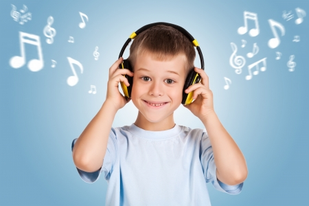 attracive: attracive kid is listening music with headphones
