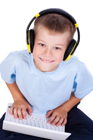 attracive: attracive kid is listening music with headphones and laptop