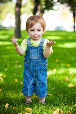baby love: happy baby resting on the green grass