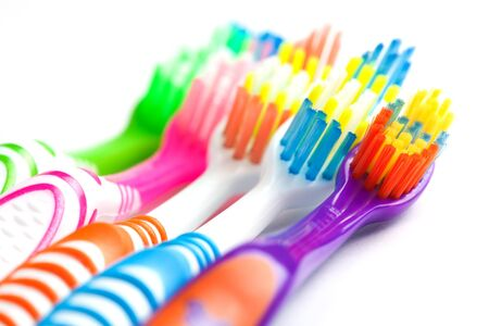 bristle: set of multicolored toothbrushes isolated on white Stock Photo