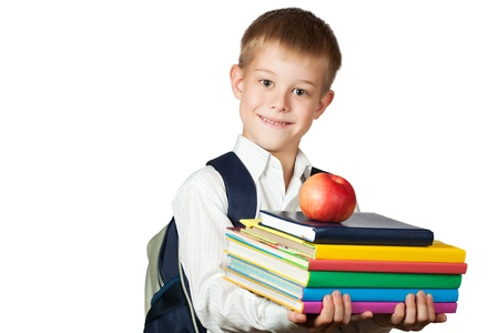 Cute boy is holding books and apple  isolated Stock Photo - 15719359