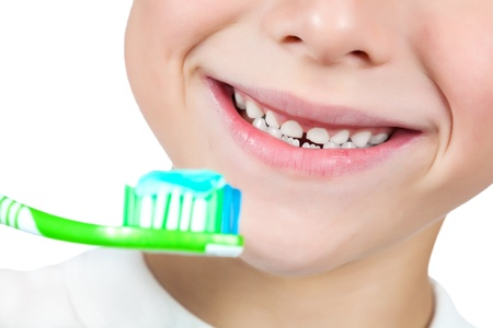 bristle: boy is brushing his teeth  isolated