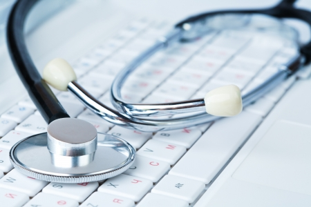 Stethoscope on a modern keyboard photo