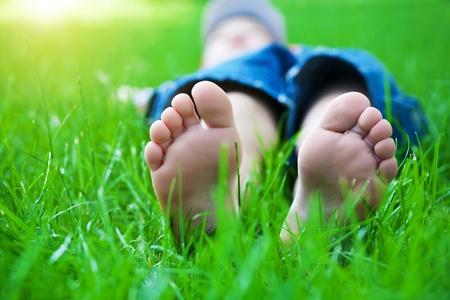 feet on grass  Family picnic in spring park Standard-Bild
