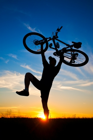 viewfinderchallenge3: cyclist with a bike silhouette on blue sky Stock Photo