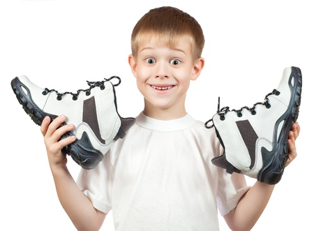 walking shoes: portrait of a boy with a new white shoes