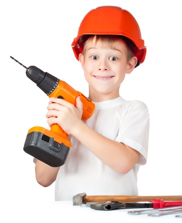 cheerful little boy with electric screwdriver photo