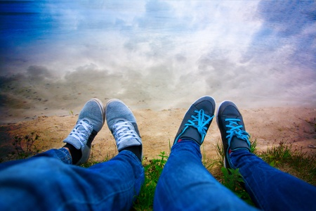 two pairs of legs on the lake shore  sky Stock Photo - 16887237