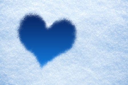 blue Heart from ice on snow background photo
