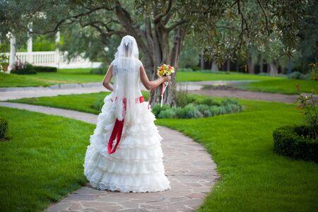 bride is walkingin the green park Stock Photo - 16977291
