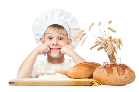 little boy scullion is kneading dough photo