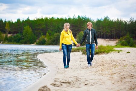 couple are walking on the beach Stock Photo - 17276989