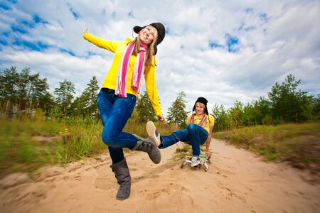 Funny couple are sledding at summer Stock Photo - 17412891
