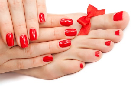Relaxing Red manicure and pedicure with a bow  isolated Stockfoto