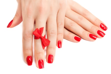 red manicure with a bow isolated photo